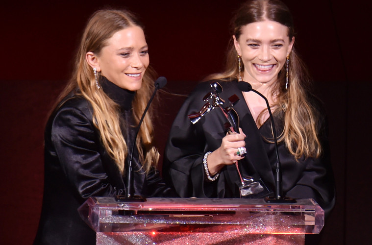 NEW YORK, NY - JUNE 01:  Ashley Olson and Mary-Kate Olson accept the Womenswear Designer of the Year Award onstage at the 2015 CFDA Fashion Awards at Alice Tully Hall at Lincoln Center on June 1, 2015 in New York City.  (Photo by Michael Loccisano/Getty Images)