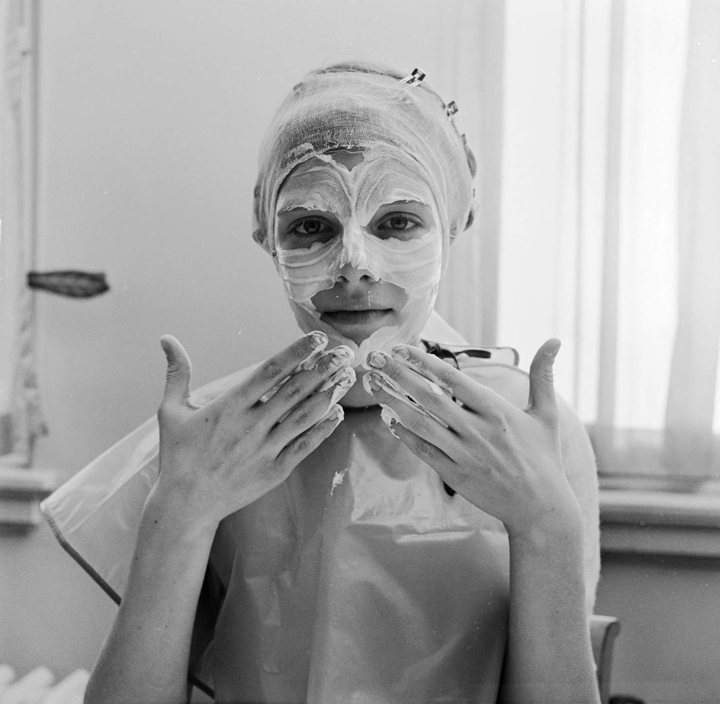 circa 1955:  A woman gently applying skin cream to her face with the tips of her fingers.  (Photo by Orlando /Three Lions/Getty Images)