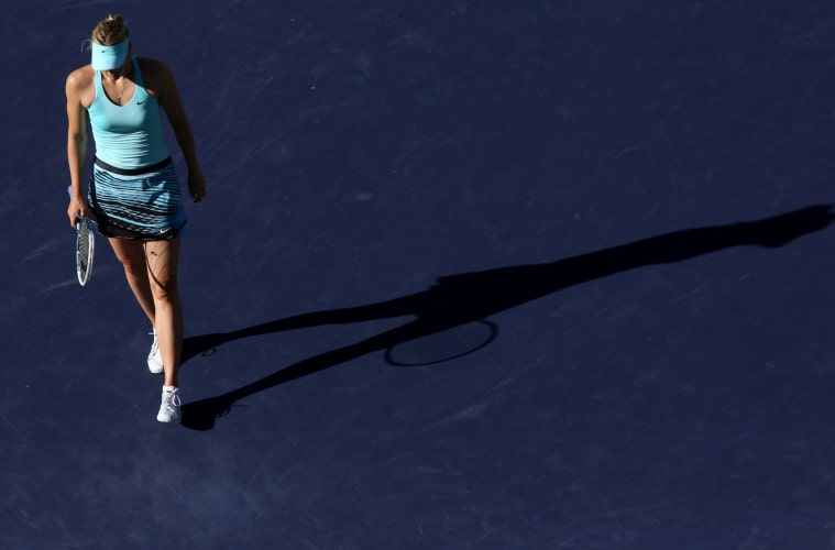 INDIAN WELLS, CA - MARCH 10:  Maria Sharapova of Russia walks on the court during her match with Camila Giorgi of Italy during the BNP Paribas Open at Indian Wells Tennis Garden on March 9, 2014 in Indian Wells, California.  Giorgi won 6-3, 4-6, 7-5.  (Photo by Stephen Dunn/Getty Images).  (Photo by Stephen Dunn/Getty Images)