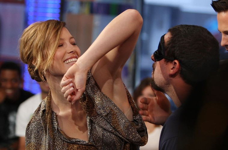 NEW YORK - JULY 16:  (U.S. TABS OUT)  Adam Sandler sniffs Jessica Biel's armpit during MTV's Total Request Live at the MTV Times Square Studios on July 16, 2007 in New York City.  (Photo by Scott Gries/Getty Images)