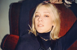 Feature, interview with Chloe Sevigny, Q&A, looking back, fashion, relates to book release, portrait, relaxed, chair, wears leather dress, poloneck by Wolford, gold necklace by Arabella Bianco, silver cuffs by Slim Barrett