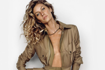 Cover feature, interview with Gisele Bundchen, power, force, mogul, studio portrait of model, curly hair, tanned, summer clothing, utility, safari, wears jacket and shorts, both by Ralph Lauren Collection, bikini bottoms by Heidi Klein