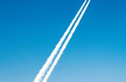 planes flying over poster advertising clubs,  landing into Ibiza airport,  Ibiza, Balearics, Spain. ©Naki Kouyioumtzis/ Axiom.