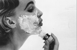 A woman applying a face mask with a shaving brush. Original Publication: Housewife Magazine - pub. 1956   (Photo by Hulton Archive/Getty Images)