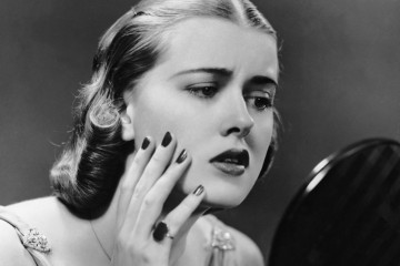 UNITED STATES - CIRCA 1950s:  Portrait of upset woman looking in hand mirror.  (Photo by George Marks/Retrofile/Getty Images)