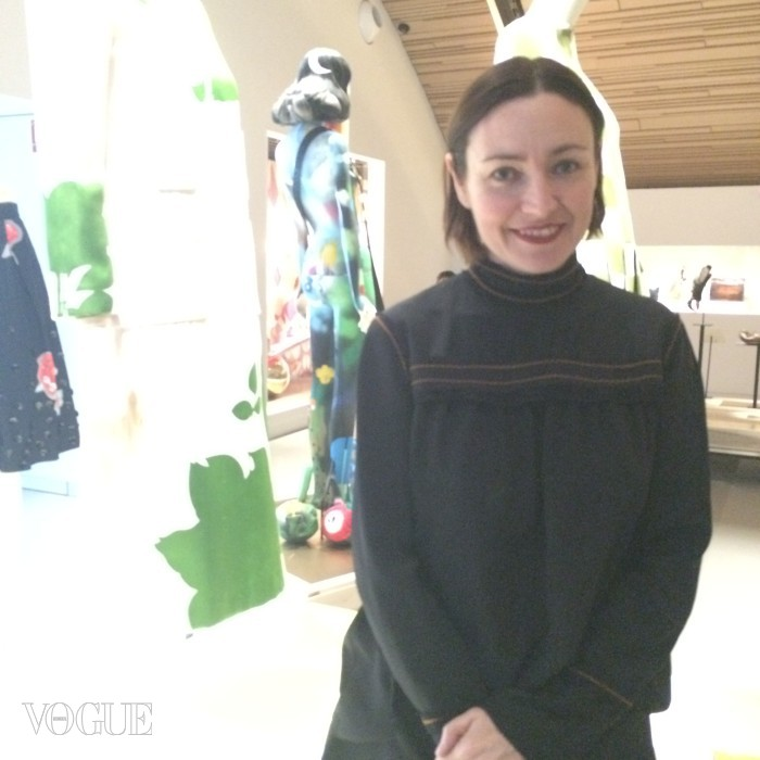 Judith Clark, curator of the Louis Vuitton exhibition, in front of an LV fashion display