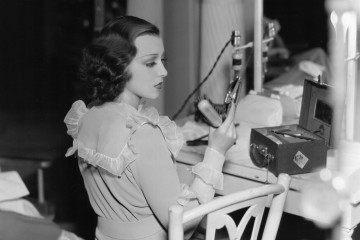 circa 1934:  Frances Drake applies a few last minute touches to her make-up before going onto the set of her latest film, 'Ladies Should Listen', directed by Frank Tuttle for Paramount.  (Photo by Hulton Archive/Getty Images)