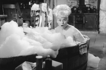 1963:  Barbara Windsor in a bubble bath during filming of 'Crooks in the Cloisters'.  (Photo by John Pratt/Keystone Features/Getty Images)