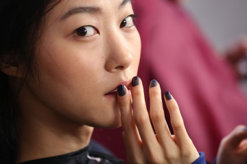 NEW YORK, NY - FEBRUARY 13:  A model gets her nails painted backstage at Wes Gordon runway show during MADE Fashion Week Fall 2015 at Milk Studios on February 13, 2015 in New York City.  (Photo by Mireya Acierto/Getty Images)
