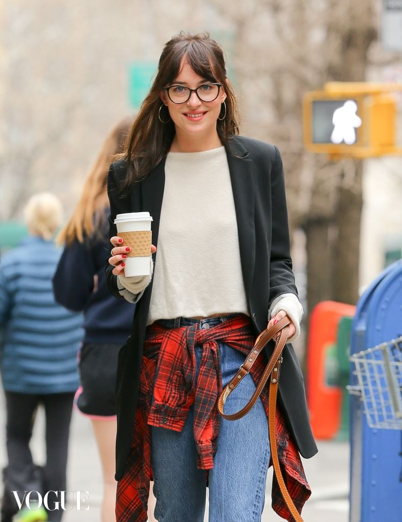Dakota Johnson spotted holding her coffee while she goes for a walk with her dog in New York City