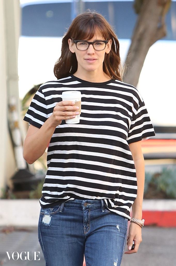 Jennifer Garner is all smiles looking smart with her glasses carrying her coffee