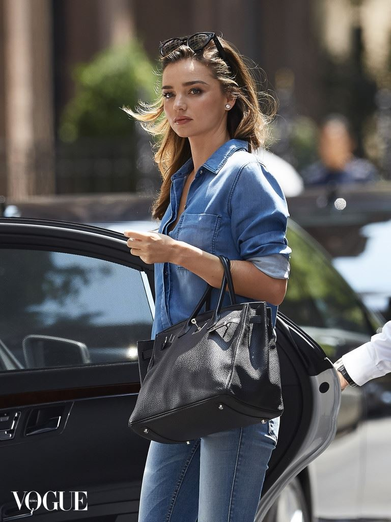 Miranda Kerr seen wearing double denim outfit and leopard print heels while stepping out of her car in NYC