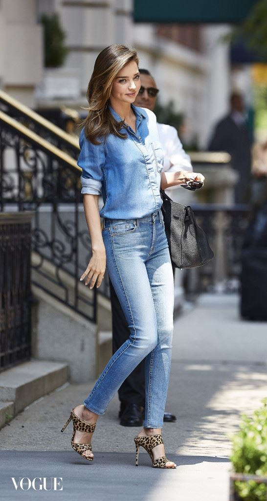Miranda Kerr seen wearing leopard print stilettos and denim shirt while departing her apartment in NYC