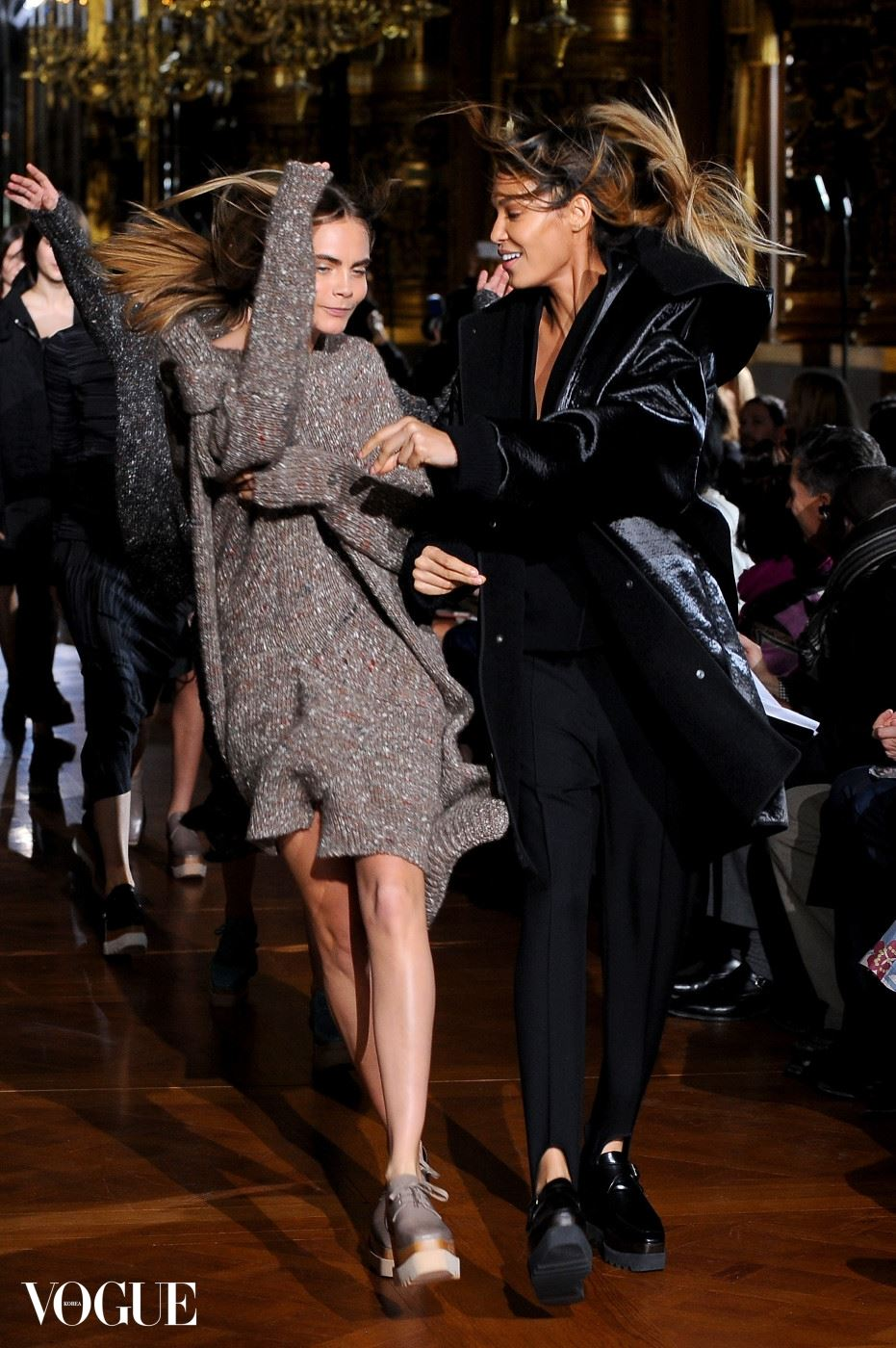 PARIS, FRANCE - MARCH 03:  Joan Smalles and Cara Delevigne walk the runway during the Stella McCartney show as part of the Paris Fashion Week Womenswear Fall/Winter 2014-2015  on March 3, 2014 in Paris, France.  (Photo by Francois Durand/Getty Images)