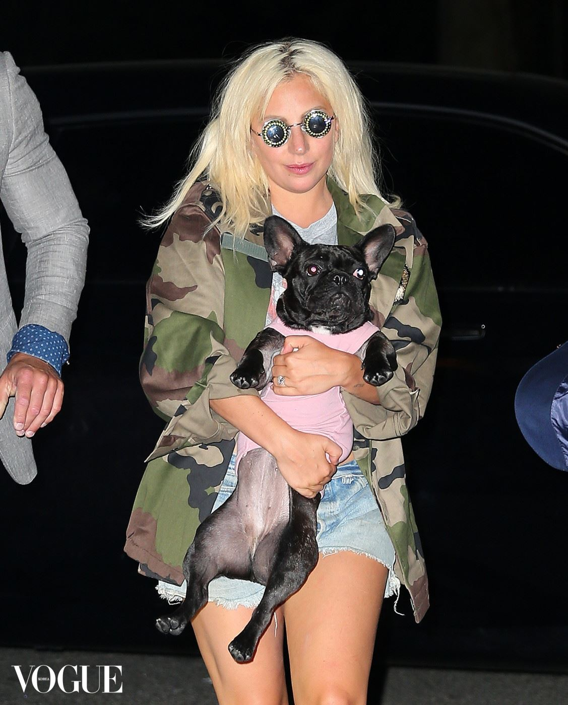 Lady Gaga appears to stumble down the stairs while departing her show at Radio City in NYC with her dog Asia. Pictured: Lady Gaga Ref: SPL1060433  220615   Picture by: XactpiX / Splash News Splash News and Pictures Los Angeles:	310-821-2666 New York:	212-619-2666 London:	870-934-2666 photodesk@splashnews.com