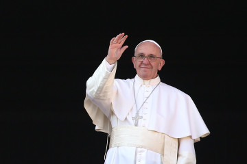 VATICAN CITY, VATICAN - DECEMBER 25:  Pope Francis waves to the faithful as he delivers his 'Urbi et Orbi' blessing message from the central balcony of St Peter's Basilica on December 25, 2015 in Vatican City, Vatican. During his Christmas message Pontiff Sayd ' My thoughts turn to those affected by brutal acts of terrorism, particularly the recent massacres which took place in Egyptian airspace, in Beirut, Paris, Bamako and Tunis.  (Photo by Franco Origlia/Getty Images)
