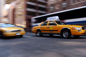 395632 04: New York City taxis speed down Broadway October 10, 2001 in New York. Taxi drivers have seen their incomes drop significantly since the terrorist attacks occurred September 11th on the World Trade Center . (Photo by Spencer Platt/Getty Images)