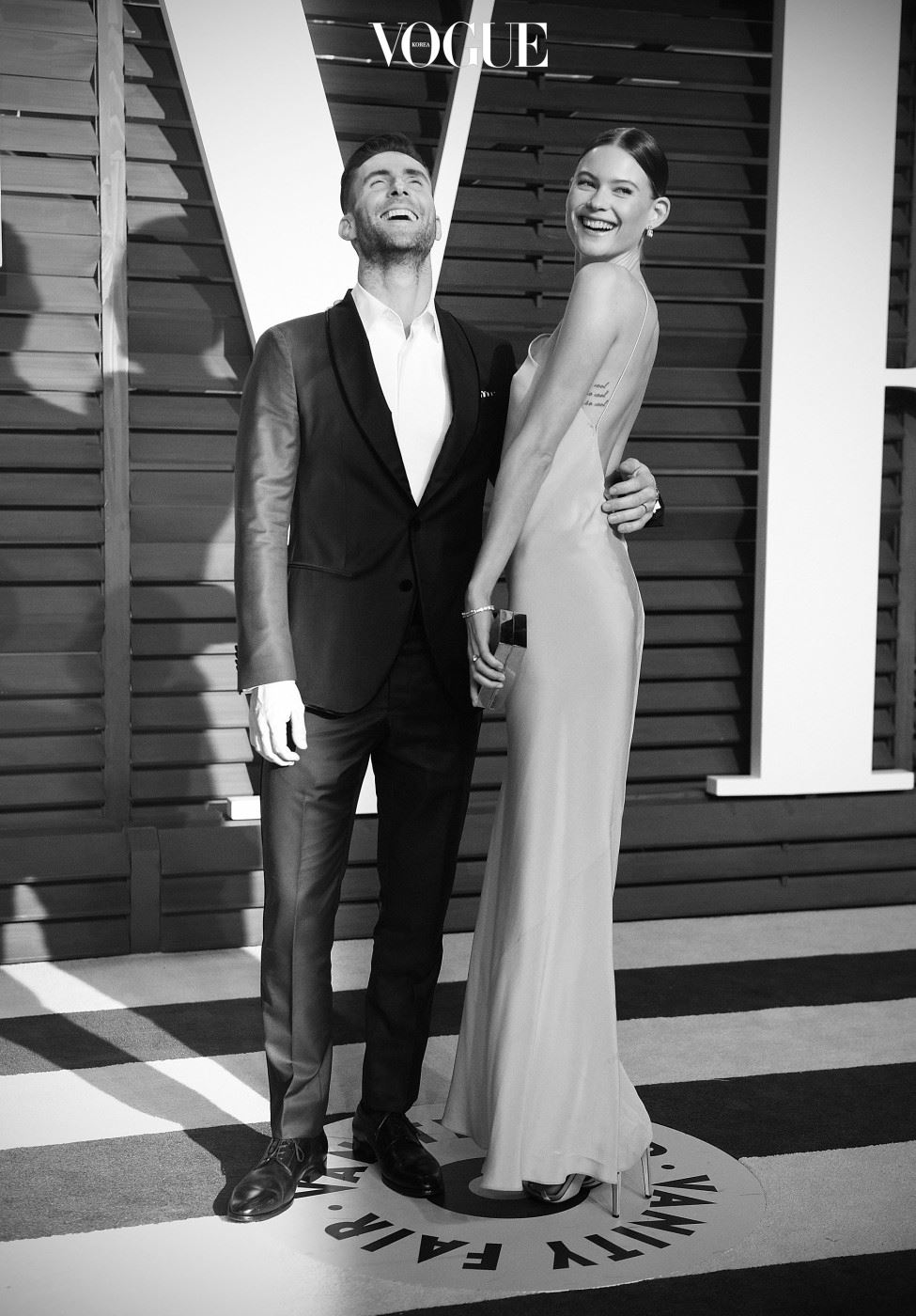 BEVERLY HILLS, CA - FEBRUARY 22:  ( Editors Note: Image processed using digital filters )  Singer Adam Levine and wife Behati Prinsloo attend the 2015 Vanity Fair Oscar Party at Wallis Annenberg Center for the Performing Arts on February 22, 2015 in Beverly Hills, California.  (Photo by Jason Kempin/Getty Images)