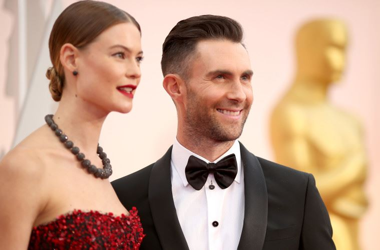 HOLLYWOOD, CA - FEBRUARY 22: Recording artist Adam Levine (R) and model Behati Prinsloo attend the 87th Annual Academy Awards at Hollywood & Highland Center on February 22, 2015 in Hollywood, California.  (Photo by Christopher Polk/Getty Images)