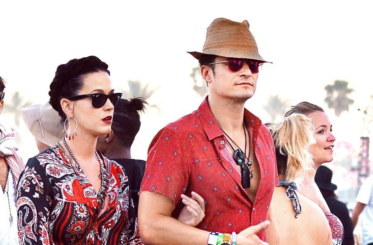 EXCLUSIVE: Orlando Bloom and girlfriend Katy Perry were spotted walking arm in arm as they enjoyed the Coachella Art and Music Festival in Indio, CA. The couple wore matching colored outfits and were seen watching Major Lazer and Diplo perform.  Pictured: Katy Perry, Orlando Bloom Ref: SPL1266206  180416   EXCLUSIVE Picture by: Sharpshooter Images / Splash   Splash News and Pictures Los Angeles:	310-821-2666 New York:	212-619-2666 London:	870-934-2666 photodesk@splashnews.com