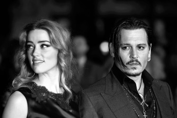 "LONDON, ENGLAND - OCTOBER 11:  (EDITOR'S NOTE: This image has been converted to black and white) Amber Heard and Johnny Depp attend the ""Black Mass"" Virgin Atlantic Gala screening during the BFI London Film Festival, at Odeon Leicester Square on October 11, 2015 in London, England.  (Photo by John Phillips/Getty Images for BFI)"