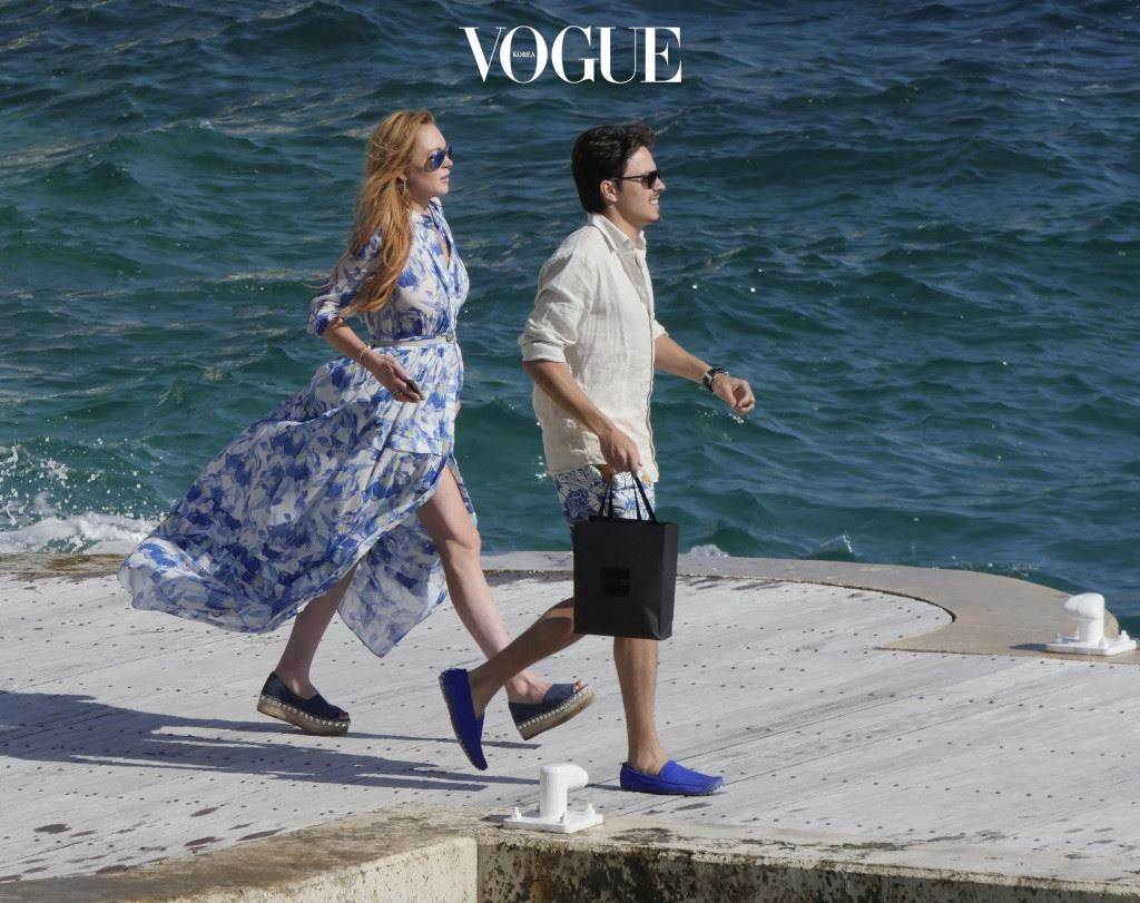 Lindsay Lohan and boyfriend Egor Tarabasov seen outside the Eden Roc Hotel in Cannes, France. The pair arrived by boat and ran into Harvey Weinstein on the dock. Pictured: Lindsay Lohan, Egor Tarabasov Ref: SPL1288024  210516   Picture by: Splash News Splash News and Pictures Los Angeles:310-821-2666 New York:212-619-2666 London:870-934-2666 photodesk@splashnews.com