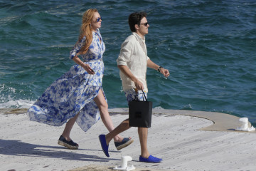 Lindsay Lohan and boyfriend Egor Tarabasov seen outside the Eden Roc Hotel in Cannes, France. The pair arrived by boat and ran into Harvey Weinstein on the dock.  Pictured: Lindsay Lohan, Egor Tarabasov Ref: SPL1288024  210516   Picture by: Splash News  Splash News and Pictures Los Angeles:	310-821-2666 New York:	212-619-2666 London:	870-934-2666 photodesk@splashnews.com