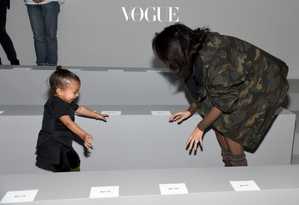 NEW YORK, NY - FEBRUARY 12:  Kim Kardashian (R) and daughter North attend the adidas Originals x Kanye West YEEZY SEASON 1 fashion show during New York Fashion Week Fall 2015 at Skylight Clarkson Sq on February 12, 2015 in New York City.  (Photo by Dimitrios Kambouris/Getty Images for adidas)