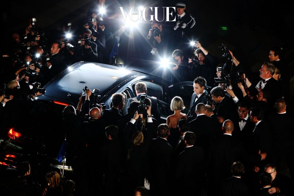 CANNES, FRANCE - MAY 17:  Photographers surround the car as Johnny Hallyday departs the Vengeance Premiere at the Palais Des Festivals during the 62nd International Cannes Film Festival on May 17, 2009 in Cannes, France.  (Photo by Georges De Keerle/Getty Images)