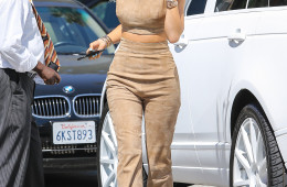 UK CLIENTS MUST CREDIT: AKM-GSI ONLY 'KUWTK' Kylie Jenner just debut her new hair extensions line yesterday but it appears the blue-haired star was already in need of a touch-up as she headed to a hair salon in Beverly Hills, CA. She was seen in a suede pant suit with black peep-toe heels.  Pictured: Kylie Jenner Ref: SPL1076067  100715   Picture by: AKM-GSI / Splash News