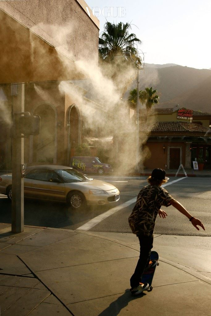 PALM SPRINGS, CA - JULY 5:  A boy rides a skateboard past a sidewalk cafe mister as temperatures hovers around 115 degrees Fahrenheit July 5, 2007 in Palm Springs, California. The first major heat wave of the summer is gripping the Southwest this week as parts of southern California experience the driest year on record.  (Photo by David McNew/Getty Images)
