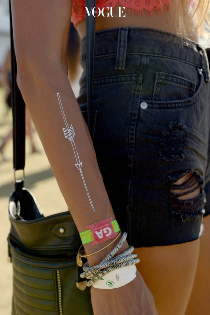 INDIO, CA - APRIL 18:  Music fans wearing metallic temporary tattoos attend day 2 of the 2015 Coachella Valley Music And Arts Festival (Weekend 2) at The Empire Polo Club on April 18, 2015 in Indio, California.  (Photo by Matt Cowan/Getty Images for Coachella)