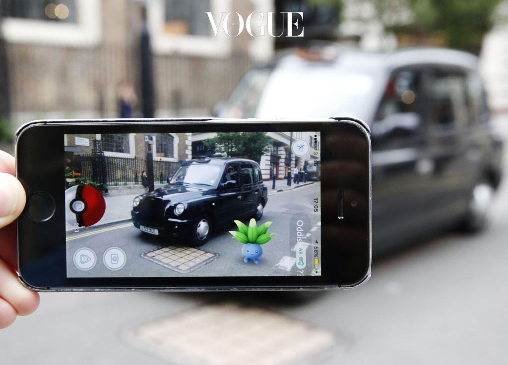 LONDON, ENGLAND - JULY 15:  An Oddish Pokemon character appears in front of a London taxi during a game of Pokemon Go, a mobile game that has become a global phenomenon, on July 15, 2016 in London, England. The app lets players roam using their phone's GPS location data and catch Pokemon to train and battle.The game has added millions to the value of Nintendo, which part-owns the franchise. (Photo by Olivia Harris/Getty Images)