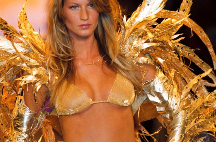 Brazilian model Gisele Bundchen models a gold bikini and gold feathers during a Victoria's Secret benefit fashion show in Cannes, France, May 18, 2000. At the 53rd International Film Festival, Cinema Against AIDS 2000 featured a screening of a Miramax film, followed by a Victoria's Secret fashion show with the benefits going to AmFAR (The American Foundation For Aids Research). (Photo by Davy and Valente/Getty Images)