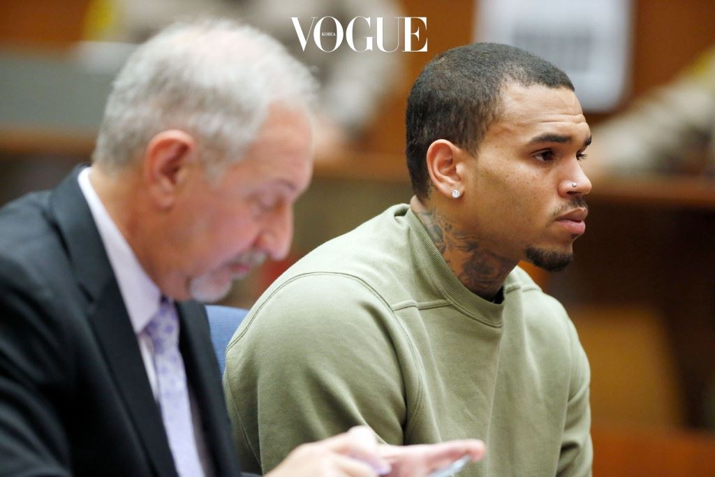 LOS ANGELES, CA - JANUARY 15:  Singer Chris Brown attends a progress hearing at Los Angeles Superior Court on January 15, 2015 in Los Angeles, California.  Brown was first placed on probation after the 2009 domestic violence case in which he plead guilty to assaulting his then-girlfriend, singer Rihanna.  (Photo by Lucy Nicholson - Pool/Getty Images)