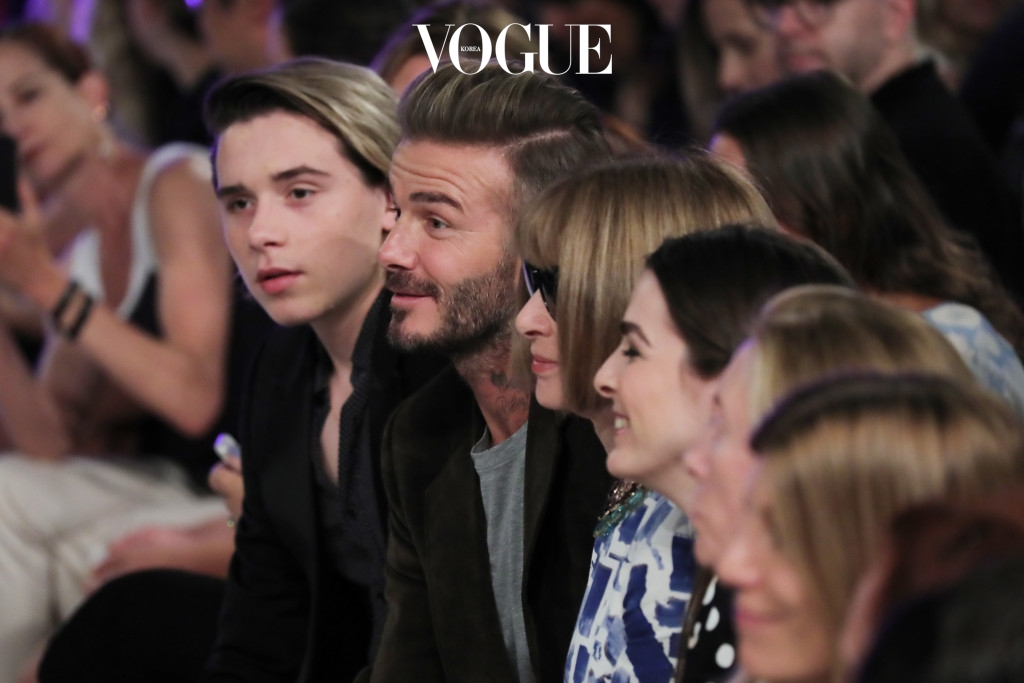 NEW YORK, NY - SEPTEMBER 11:  Brooklyn Beckham, David Beckham, and Anna Wintour attend the Victoria Beckham Spring/Summer 2017 fashion show during New York Fashion Week 2016 on September 11, 2016 in New York City.  (Photo by Neilson Barnard/Getty Images)