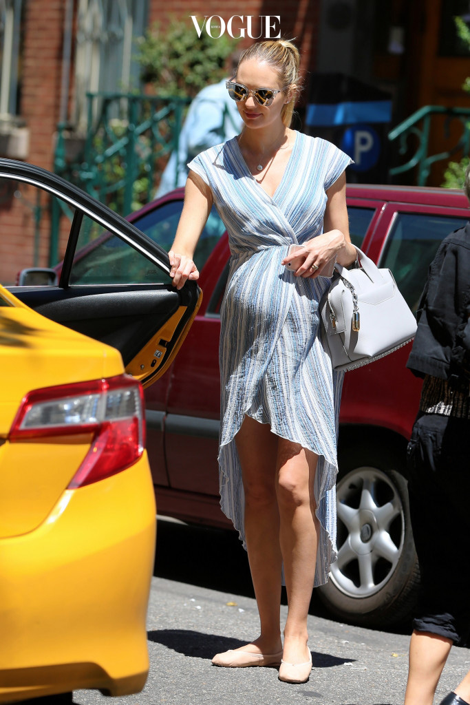 EXCLUSIVE: Pregnant model Candice Swanepoel, wearing a blue striped summer wrap dress and flats, and her mother Eileen Swanepoel head to lunch in New York City on Jun 10, 2016. Pictured: Candice Swanepoel Ref: SPL1299781  100616   EXCLUSIVE Picture by: Christopher Peterson/Splash News Splash News and Pictures Los Angeles:310-821-2666 New York:212-619-2666 London: 870-934-2666 photodesk@splashnews.com
