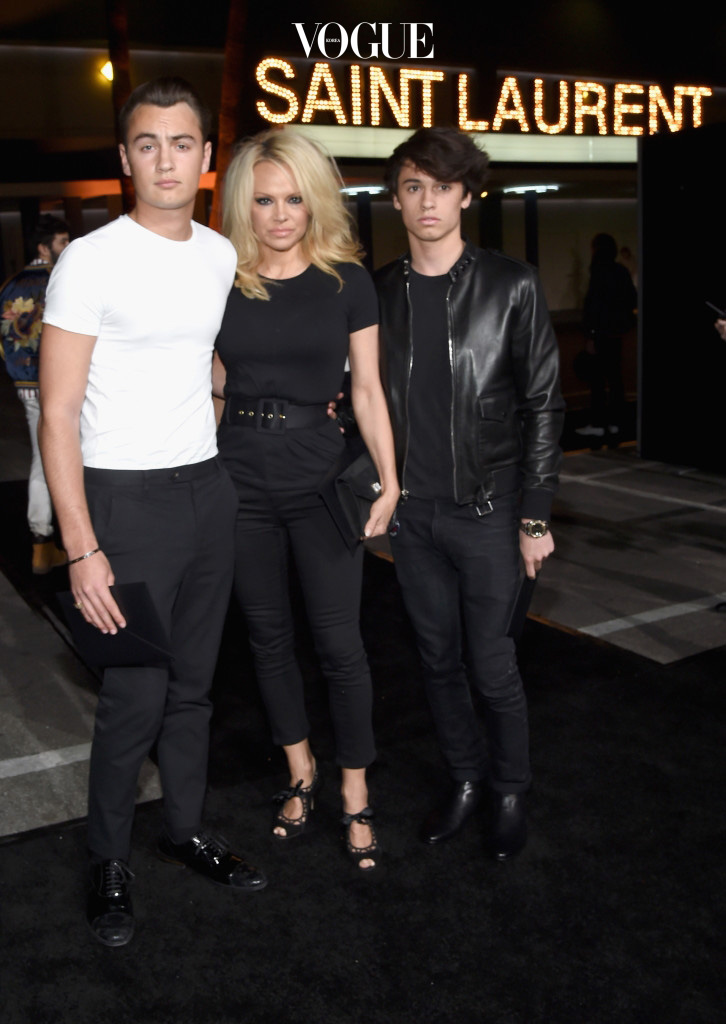 LOS ANGELES, CA - FEBRUARY 10: (L-R) Brandon  Lee, actress Pamela Anderson and model Dylan Lee,  in Saint Laurent by Hedi Slimane, attend Saint Laurent at the Palladium on February 10, 2016 in Los Angeles, California for the Saint Laurent Los Angeles show.  (Photo by Larry Busacca/Getty Images for SAINT LAURENT)