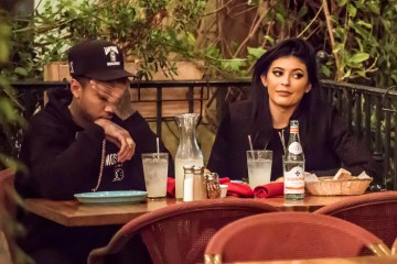 UK CLIENTS MUST CREDIT: AKM-GSI ONLY EXCLUSIVE: *SHOT ON 9/27/15* **WEB EMBARGO UNTIL 01:30 PM PST 10/01/15** Calabasas, CA - 'KUWTK', Kendall Jenner, and her boyfriend Tyga appeared to be uninterested in each other as they dined together at Rosti Cafe.  While Kylie seemed to be more interested in her phone, Tyga looked to be bored and was seen looking at the ceiling and rubbing his head as he patiently waited for Kylie to pay him any attention. He was seen chowing down on his pasta while Kylie barely touched hers and seemed preoccupied on a phone conversation.  The couple were so glued to their iPhones that they barely noticed each other.  Nonetheless, Tyga was still the gentleman, reaching for his wallet when it was time to pay the bill.  Pictured: Kourtney Kardashian Ref: SPL1140844  300915   EXCLUSIVE Picture by: AKM-GSI / Splash News