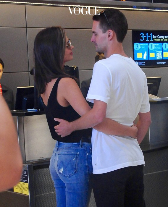 Miranda Kerr and boyfriend Evan Spiegel at LAX airport Pictured: Miranda Kerr and Evan Spiegel Ref: SPL1075379  120815   Picture by: Giovanni / Splash News Splash News and Pictures Los Angeles:310-821-2666 New York: 212-619-2666 London:870-934-2666 photodesk@splashnews.com
