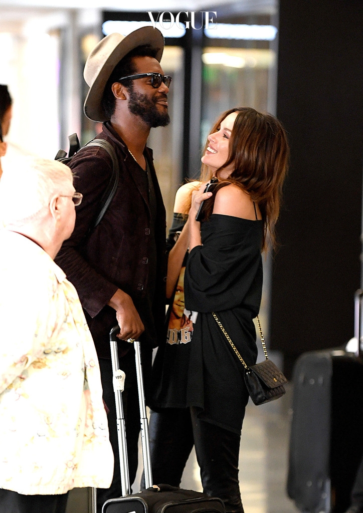 EXCLUSIVE: **EXCLUSIVE**  Photo Credit: MOVI Inc.  Date: September 26th 2016 Sporting a Rihanna t-shirt Australian model Nicole Trunfio gets a cuddle from her rocker husband Gary Clark Jr as the pair touch down at the Los Angeles International airport. NO DAILY MAIL ONLINE Pictured: Nicole Trunfio, Gary Clark Jr Ref: SPL1377704  201016   EXCLUSIVE Picture by: MOVI Inc. / Splash News Splash News and Pictures Los Angeles:310-821-2666 New York: 212-619-2666 London:870-934-2666 photodesk@splashnews.com