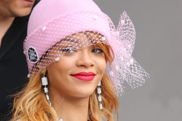 Barbadian popstar Rihanna seen here leaving her Ireland Hotel and heading to the airport to catch a private jet to Amsterdam to continue her Diamonds tour. Rihanna wore a white jumper and a pair of denim overalls with a pair of Converse trainers and a pink beanie hat with veil.  Pictured: Rihanna Ref: SPL566512  220613   Picture by: WeirPhotos / Splash News  Splash News and Pictures Los Angeles:	310-821-2666 New York:	212-619-2666 London:	870-934-2666 photodesk@splashnews.com