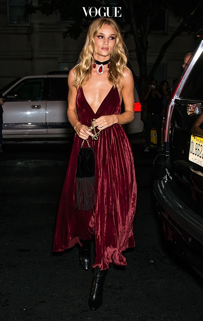 Rosie Huntington-Whiteley arrives at Ralph Lauren fashion show in New York City on September 14, 2016 wearing red velvet dress paired with choker necklace, black velvet pouch handbag and  black boots Pictured: Rosie Huntington-Whiteley Ref: SPL1354251  140916   Picture by: Ouzounova/Splash News Splash News and Pictures Los Angeles:310-821-2666 New York:212-619-2666 London: 870-934-2666 photodesk@splashnews.com