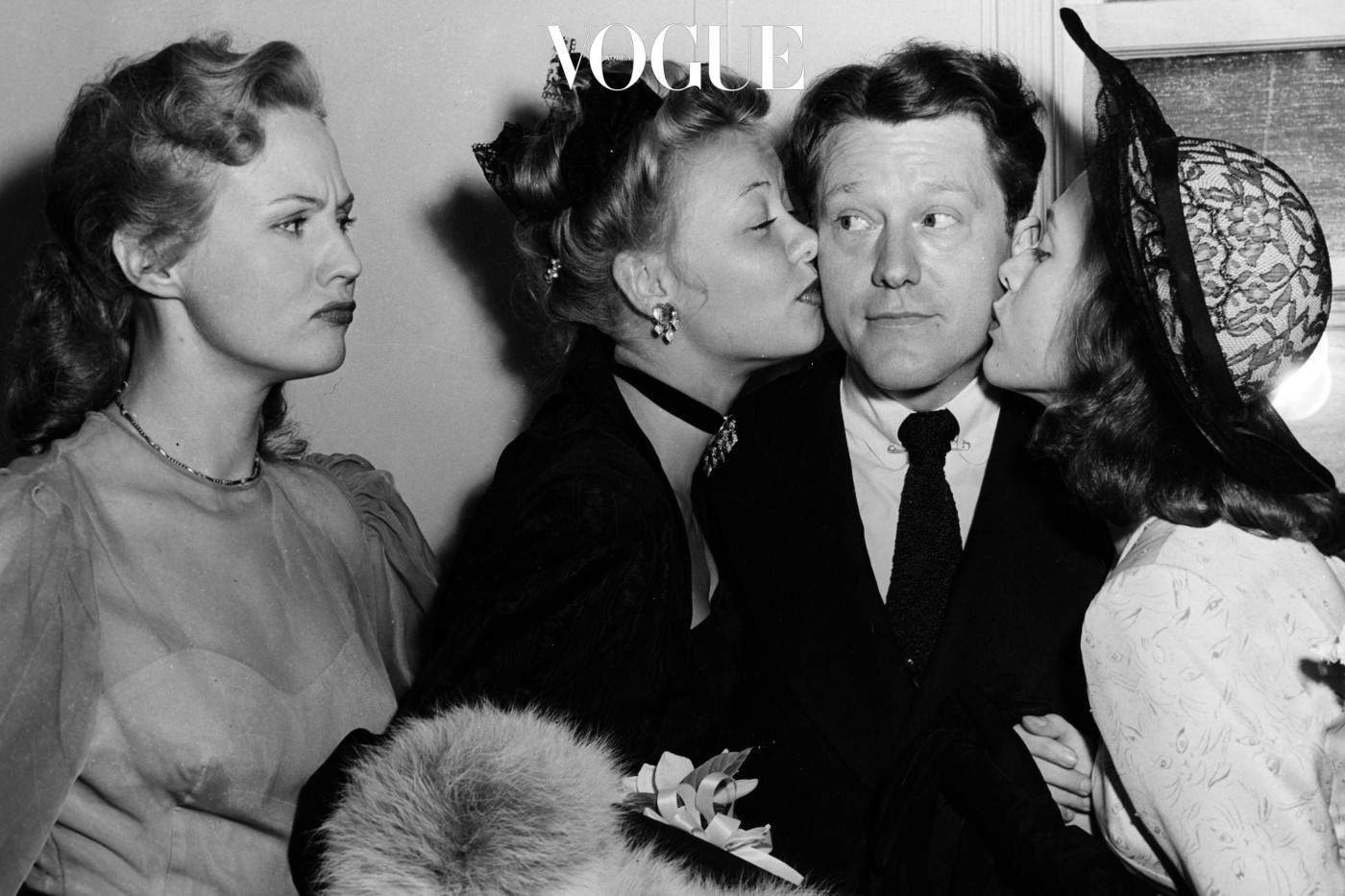 Actresses Vera Ellen and Cathy O'Donnell kiss the cheek of actor Michael O'Shea on his wedding day, as his bride Virginia Mayo frowns, at the Little Church of the Flowers, Hollywood, 1947. (Photo by Hulton Archive/Getty Images)