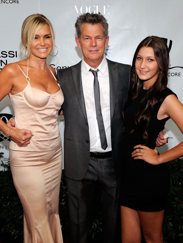LAS VEGAS - OCTOBER 09:  Yolanda Hadid, musician/music producer David Foster, and Bella Hadid arrive at the Andre Agassi Foundation for Education's 15th Grand Slam for Children benefit concert at the Wynn Las Vegas October 9, 2010 in Las Vegas, Nevada. The event raises funds to help improve education for underserved youth in the Las Vegas community.  (Photo by Ethan Miller/Getty Images)