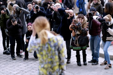 PARIS, FRANCE - JANUARY 27:  (EDITORS NOTE: Image has been digitally retouched) Streetstyle photographers outside the Chanel show as part of Paris Fashion Week Haute Couture Spring/Summer 2015 at the Grand Palais on January 27, 2015 in Paris, France.  (Photo by Gareth Cattermole/Getty Images)