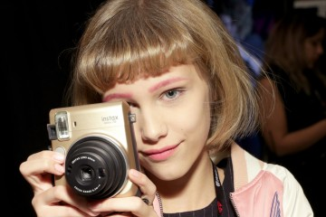 NEW YORK, NY - DECEMBER 09:  Grace VanderWaal poses with Fujifilm Instax Mini during Z100's artist gift lounge during Jingle Ball 2016 at Madison Square Garden on December 9, 2016 in New York City.  (Photo by Cindy Ord/Getty Images for iHeart)