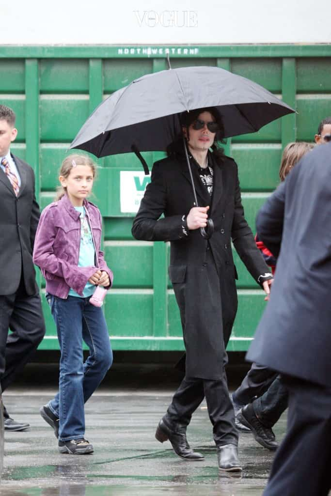 Michael Jackson walks with kids Prince and Paris through a studio parking lot in Los Angeles. The singer had been spotted with his entourage going to a studio on a cold rainy day in LA. Walking through the lot, the kids initially didn't have their usual masks on, it was only after they realized that they could be seen from the street that the kids emerged from a building wearing masquerade type masks. Michael stayed at the studio for over two hours, and there were many production people working around him suggesting that MJ was filming. After some time Michael emerged carrying his own umbrella before getting into his limo and being driven off. Pictured: Michael Jackson and Paris  Ref: SPL104102  030609   Picture by: Splash News Splash News and Pictures Los Angeles:310-821-2666 New York:212-619-2666 London: 870-934-2666 photodesk@splashnews.com