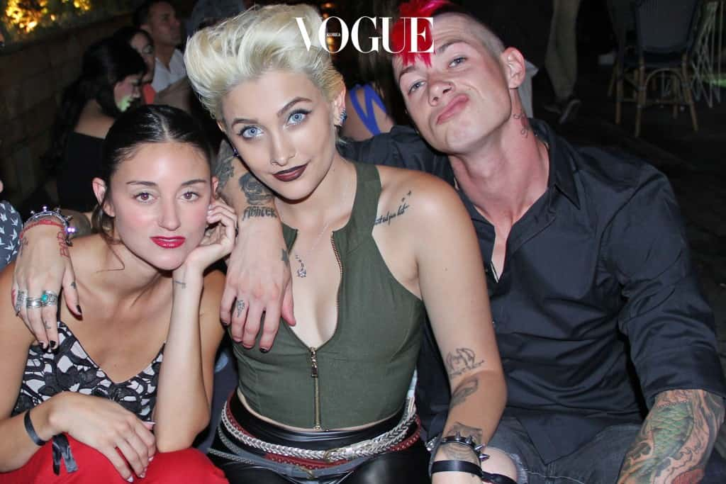 "EXCLUSIVE: Paris Jackson, boyfriend Michael Snoddy, Caroline D'Amore and friends attend the launch of Flaunt Magazine's ""Oh La La Land"" issue in LA, which includes a story and editorial spread on the group. Pictured: Caroline D'Amore, Paris Jackson, Michael Snoddy Ref: SPL1360737  230916   EXCLUSIVE Picture by: Royal Rebel PR Splash News and Pictures Los Angeles:310-821-2666 New York: 212-619-2666 London:870-934-2666 photodesk@splashnews.com"