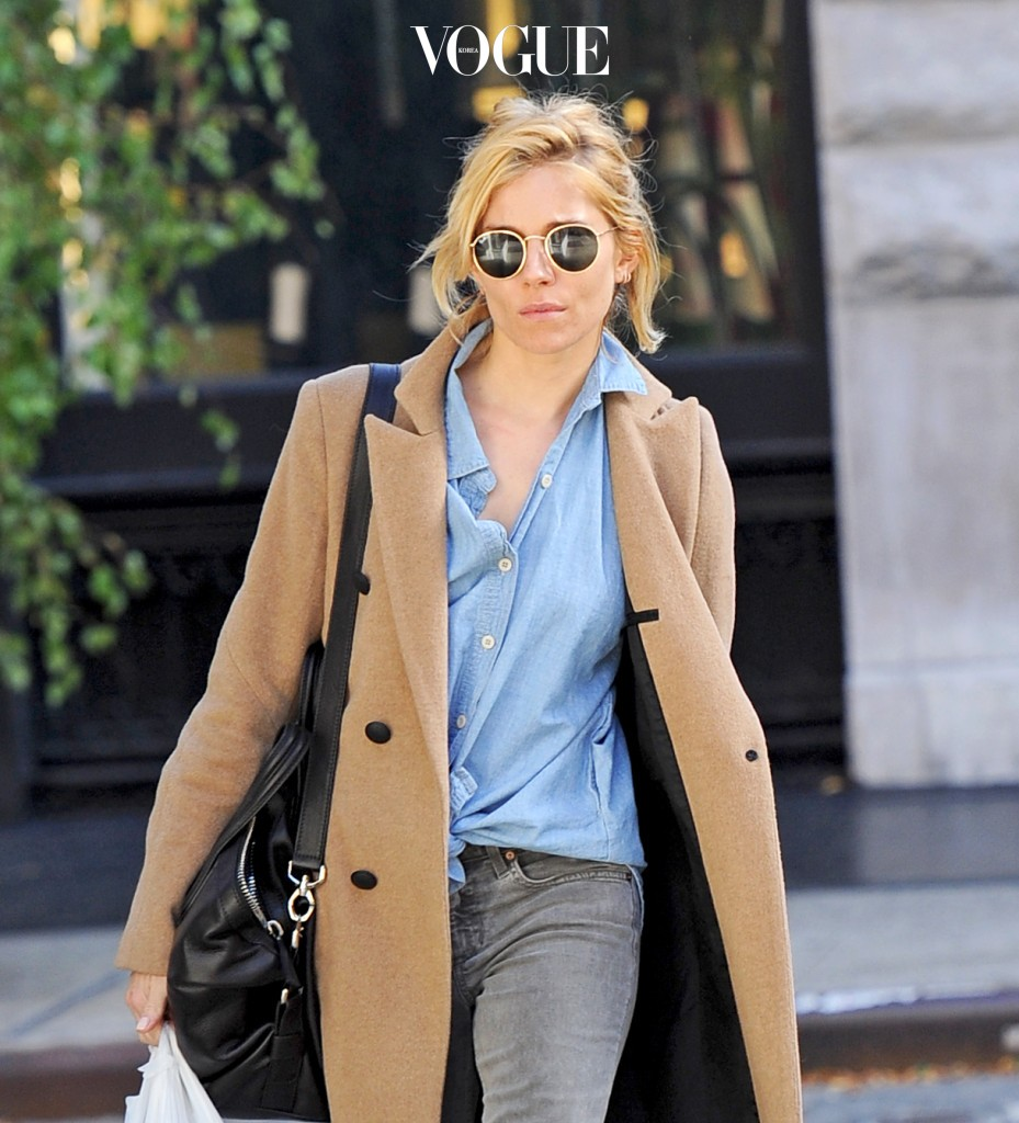 Sienna Miller looked striking as she stepped out without any makeup on. She was running errands in SoHo, NYC and took a stroll while wearing a beige pea coat with a blue denim button up shirt. Pictured: Sienna Miller Ref: SPL1172493  091115   Picture by: Splash News Splash News and Pictures Los Angeles:310-821-2666 New York:212-619-2666 London:870-934-2666 photodesk@splashnews.com
